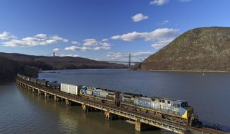 FILE- In this April 26, 2018, file photo, a CSX Transportation locomotive pulls a train of tank cars across a bridge on the Hudson River along the edge of Bear Mountain State Park, near Fort Montgomery, N.Y. CSX Corp. reports financial results Wednesday, Jan. 16, 2019. (AP Photo/Julie Jacobson, File)