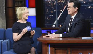 "This image released by CBS shows Sen. Kirsten Gillibrand, D- N.Y. with host Stephen Colbert during a taping of ""The Late Show With Stephen Colbert,"" Tuesday, Jan. 15, 2019 in New York. The New York Democrat announced that she is forming an exploratory committee to run for President in 2020. (Scott Kowalchyk/CBS via AP)"