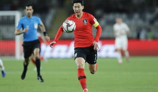 South Korea's forward Son Heung-Min runs with the ball during the AFC Asian Cup group C soccer match between South Korea and China at Al Nahyan Stadium in Abu Dhabi, United Arab Emirates, Wednesday, Jan. 16, 2019. (AP Photo/Hassan Ammar)