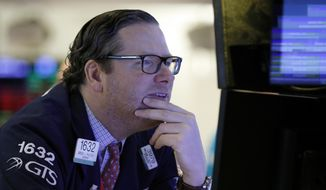 nullFILE- In this Jan. 11, 2019, file photo, specialist Gregg Maloney works on the floor of the New York Stock Exchange. The U.S. stock market opens at 9:30 a.m. EST on Wednesday, Jan. 16. (AP Photo/Richard Drew, File)