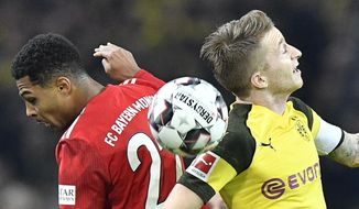 In this Saturday, Nov. 10, 2018, file photo, Bayern's Serge Gnabry, left, and Dortmund's Marco Reus challenge for the ball during the German Bundesliga soccer match between Borussia Dortmund and Bayern Munich in Dortmund, Germany. (AP Photo/Martin Meissner)