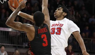 Houston guard Armoni Brooks (3) defends as SMU guard Jimmy Whitt Jr. (33) leaps to the basket for a shot in the first half of an NCAA college basketball game, Wednesday, Jan. 16, 2019, in Dallas. (AP Photo/Tony Gutierrez)