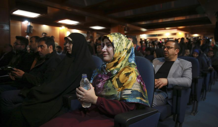 A woman weeps while a video clip is shown about an American-born news anchor working for Iranian state television's English-language service, Marzieh Hashemi, during a press briefing by Paiman Jebeli, deputy chief of Iran's state IRIB broadcaster, in Tehran, Iran, Wednesday, Jan. 16, 2019. Hashemi has been arrested after flying into the U.S., the broadcaster reported Wednesday. The reported detention of Press TV's Hashemi, born Melanie Franklin of New Orleans, comes as Iran faces increasing criticism of its own arrests of dual nationals and others with Western ties. (AP Photo/Vahid Salemi)