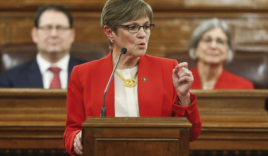 Kansas Gov. Laura Kelly gives her first State of the State address to lawmakers on the floor of the Kansas House on Wednesday, Jan. 16, 2019, in Topeka, Kan. (Chris Neal/The Topeka Capital-Journal via AP)