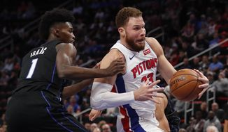 Detroit Pistons forward Blake Griffin (23) drives as Orlando Magic forward Jonathan Isaac (1) defends during the first half of an NBA basketball game, Wednesday, Jan. 16, 2019, in Detroit. (AP Photo/Carlos Osorio)