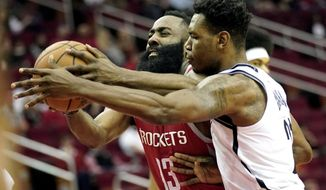 Houston Rockets' James Harden (13) is fouled by Brooklyn Nets' Treveon Graham during the first half of an NBA basketball game Wednesday, Jan. 16, 2019, in Houston. (AP Photo/David J. Phillip)