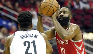 Houston Rockets' James Harden (13) shoots as Brooklyn Nets' Treveon Graham (21) defends during the first half of an NBA basketball game Wednesday, Jan. 16, 2019, in Houston. (AP Photo/David J. Phillip)
