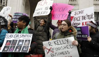 """Demonstrators chant during an R. Kelly protest outside Sony headquarters, in New York, Wednesday, Jan. 16, 2019.  Kelly has been under fire since the recent airing of a Lifetime documentary """"Surviving R. Kelly ."""" He has denied all allegations of sexual misconduct involving women and underage girls. (AP Photo/Richard Drew)"""