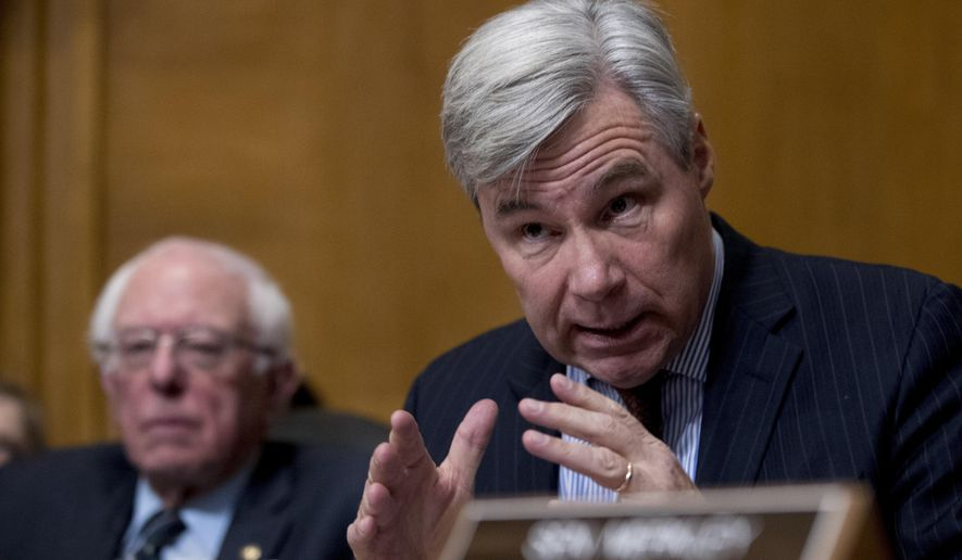 Sen. Sheldon Whitehouse, D-R.I., right, accompanied by Sen. Bernie Sanders, I-Vt., left, questions Andrew Wheeler as he testifies at a Senate Environment and Public Works Committee hearing to be the administrator of the Environmental Protection Agency, on Capitol Hill in Washington, Wednesday, Jan. 16, 2019. (AP Photo/Andrew Harnik)