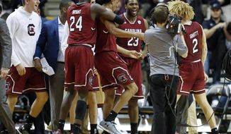 South Carolina players celebrate after defeating Vanderbilt 74-71 in an NCAA college basketball game Wednesday, Jan. 16, 2019, in Nashville, Tenn. (AP Photo/Mark Humphrey)