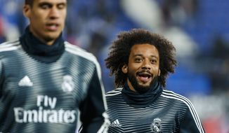 Real Madrid's Marcelo warms up prior of a Spanish Copa del Rey soccer match between Leganes and Real Madrid at the Butarque stadium in Leganes, Spain, Wednesday, Jan. 16, 2019. (AP Photo/Valentina Angela)