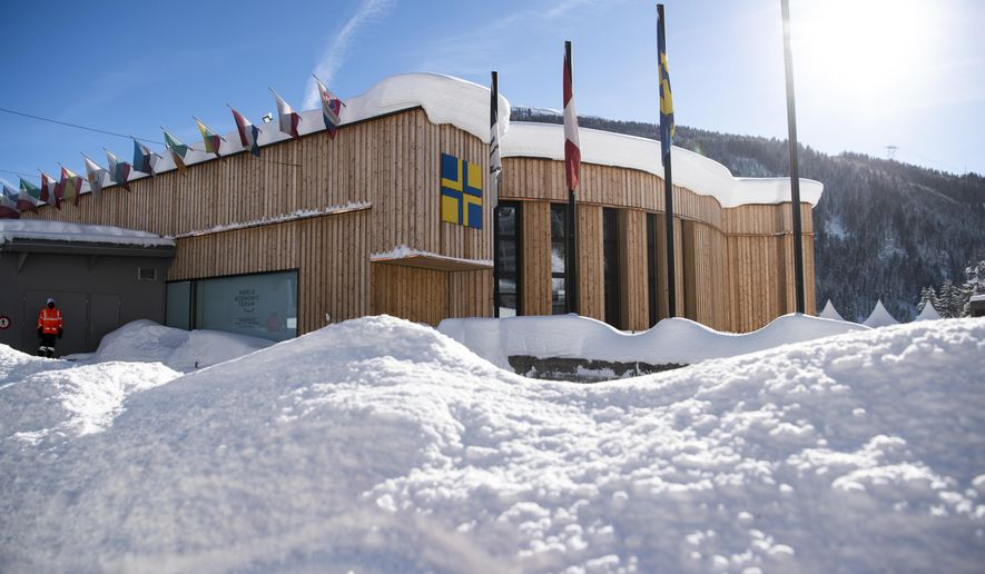 The congress centre, venue for the World Economic Forum, is covered with snow in Davos, Switzerland, Tuesday, Jan. 15, 2019. The World Economic Forum will take place in Davos from Jan. 22, 2019 until Jan. 25, 2019. (Gian Ehrenzeller/Keystone via AP)