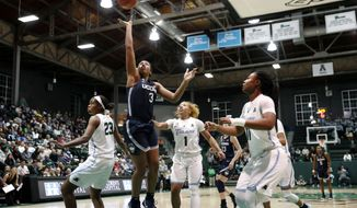 Connecticut guard Megan Walker (3) goes to the basket over Tulane guard Kaila Anderson (1), forward Krystal Freeman (23) and guard Tatyana Lofton (11) in the first half of an NCAA college basketball game in New Orleans, Wednesday, Jan. 16, 2019. (AP Photo/Gerald Herbert)