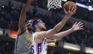 Philadelphia 76ers guard Ben Simmons (25) shoots next to Indiana Pacers center Myles Turner (33) during the first half of an NBA basketball game in Indianapolis, Thursday, Jan. 17, 2019. (AP Photo/Michael Conroy)