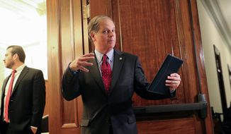 Sen. Doug Jones, D-Ala., arrives for a meeting on immigration with other senators Wednesday, Jan. 24, 2018 on Capitol Hill in Washington. (AP Photo/Pablo Martinez Monsivais)