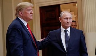U.S. President Donald Trump (left) and Russian President Vladimir Putin (right) leave the stage together at the conclusion of their joint news conference at the Presidential Palace in Helsinki, Finland, on July 16, 2018. (AP Photo/Pablo Martinez Monsivais) **FILE**