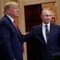 U.S. President Donald Trump, left, and Russian President Vladimir Putin, right, leave the stage together at the conclusion of their joint news conference at the Presidential Palace in Helsinki, Finland, Monday, July 16, 2018. (AP Photo/Pablo Martinez Monsivais)