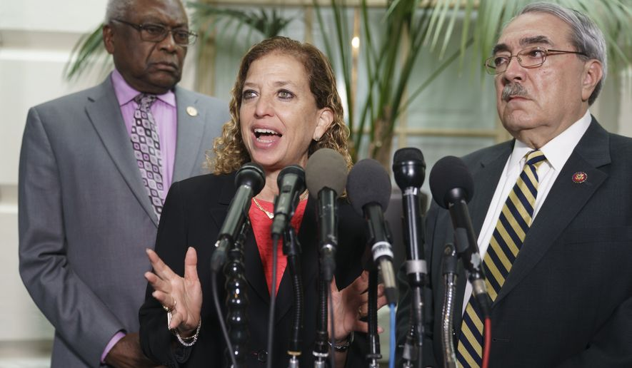 Rep. Debbie Wasserman Schultz, D-Fla., center, joined by House Majority Whip James Clyburn, D-S.C., left, and Rep. G.K. Butterfield, D-N.C., right, speaks during a news conference on Capitol Hill in Washington, Thursday, Jan. 17, 2019, following weekly Whip meeting. (AP Photo/Carolyn Kaster)