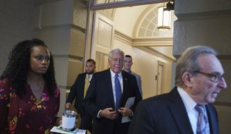 House Majority Leader Steny Hoyer of Md., second from right, and floor director Shuwanza Goff, left, walk on Capitol Hill in Washington, Thursday, Jan. 17, 2019. (AP Photo/Carolyn Kaster)