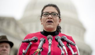 "Rep. Rashida Tlaib, D-Mich., speaks at a news conference on Capitol Hill in Washington, Thursday, Jan. 17, 2019, to unveil the ""Immediate Financial Relief for Federal Employees Act"" bill which would give zero interest loans for up to $6,000 to employees impacted by the government shutdown and any future shutdowns. (AP Photo/Andrew Harnik)"
