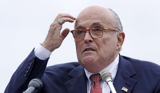 In this Aug. 1, 2018, file photo, Rudy Giuliani, an attorney for President Donald Trump, addresses a gathering during a campaign event in Portsmouth, N.H. (AP Photo/Charles Krupa, File )
