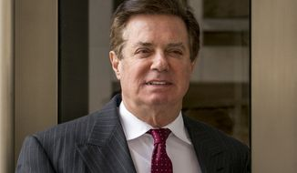 FILE - In this April 4, 2018, file photo, Paul Manafort, President Donald Trump's former campaign chairman, leaves the federal courthouse in Washington. A law firm tied to Manafort's international consulting work has agreed to pay $4.6 million and register as a foreign agent. The Justice Department announced a civil settlement Thursday, Jan. 17, 2019, with the law firm of Skadden, Arps, Slate, Meagher & Flom LLP. (AP Photo/Andrew Harnik, File)