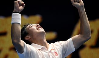 Japan's Kei Nishikori celebrates after defeating Croatia's Ivo Karlovic during their second round match at the Australian Open tennis championships in Melbourne, Australia, Thursday, Jan. 17, 2019. (AP Photo/Andy Brownbill)
