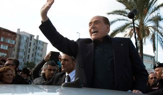 "Former Italian Premier Silvio Berlusconi waves during a visit to Monserrato, near Cagliari, Italy, Thursday, Jan. 17, 2019. The three-time Italian premier, who has made a career out of rebounding from legal woes, personal scandal, heart trouble and political setbacks, said he is running for the European Parliament in May elections. The 82-year-old Berlusconi announced his candidacy with his center-right Forza Italia party Thursday in Sardinia. He said he wanted to ""bring my voice to a Europe that should change, a Europe that has lost profound thinking about the world."" (Fabio Murru/ANSA via AP)"