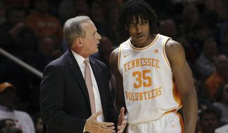 Tennessee head coach Rick Barnes speaks with Tennessee forward Yves Pons (35) in the first half of an NCAA college basketball game against Arkansas, Tuesday, Jan. 15, 2019, in Knoxville, Tenn. (AP Photo/Shawn Millsaps)