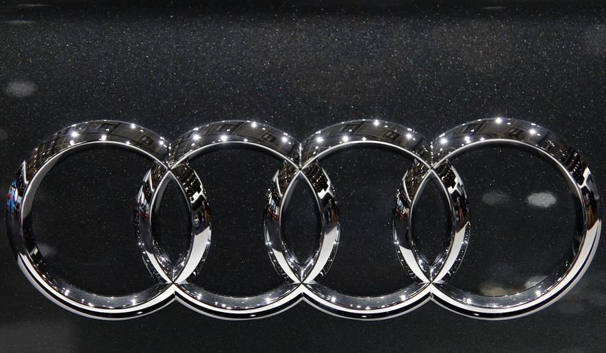 FILE - This Oct. 3, 2018, 2018, file photo shows the logo of Audi car at the Auto show in Paris, France. A federal grand jury in Detroit has indicted four Audi engineering managers from Germany in a widening diesel emissions cheating scandal. (AP Photo/Christophe Ena, File)