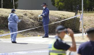 In this Wednesday, Jan. 16, 2019, photo, police investigators work at the scene where the body of Israeli student student Aiia Maasarwe was found in Melbourne, Australia. Australian police are looking for at least one attacker who killed the Israeli woman as she was walking on a city street speaking to her sister by phone. (Stefan Postles/AAP Image via AP)