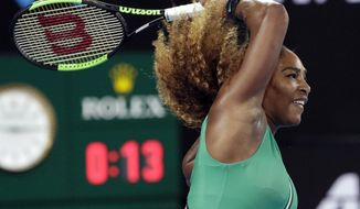 United States' Serena Williams hits forehand return to Canada's Eugenie Bouchard during their second round match at the Australian Open tennis championships in Melbourne, Australia, Thursday, Jan. 17, 2019. (AP Photo/Aaron Favila)