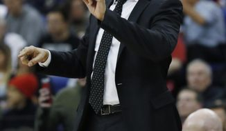 New York Knicks head coach David Fizdale gestures during an NBA basketball game between New York Knicks and Washington Wizards at the O2 Arena, in London, Thursday, Jan.17, 2019. (AP Photo/Alastair Grant)