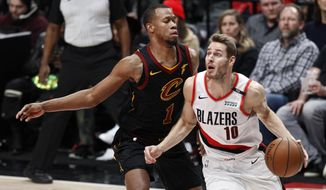 Portland Trail Blazers forward Jake Layman, right, drives against Cleveland Cavaliers guard Rodney Hood during the first half of an NBA basketball game in Portland, Ore., Wednesday, Jan. 16, 2019. (AP Photo/Steve Dipaola)