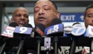 Rev. Marvin Hunter, Laquan McDonald's great-uncle, reacts as he speaks to reporters after a judge acquitted three Chicago police officers of trying to cover up the 2014 shooting of black teenager Laquan McDonald, Thursday, Jan. 17, 2019, in Chicago. Judge Domenica Stephenson said that after considering all of the evidence, including police dashcam video of the killing, she didn't find that officer Thomas Gaffney, Joseph Walsh and David March conspired to cover up the shooting. The officer who shot McDonald 16 times, Jason Van Dyke, was convicted of murder in October and is due to be sentenced Friday.(AP Photo/Nam Y. Huh)