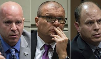 FILE - This combination of Nov. 28, 2018 file photos shows former Chicago Police officer Joseph Walsh, left, former detective David March and former officer Thomas Gaffney, accused of trying to cover up the fatal shooting of Laquan McDonald,  during a bench trial before Judge Domenica A. Stephenson at Leighton Criminal Court Building in Chicago. Judge Domenica Stephenson said Thursday, Jan. 17, 2019,  that after considering all of the evidence, including police dashcam video of the killing, she did not find that officer Thomas Gaffney, Joseph Walsh and David March conspired to cover up the shooting.  (Zbigniew Bzdak/Chicago Tribune via AP, Pool, File)