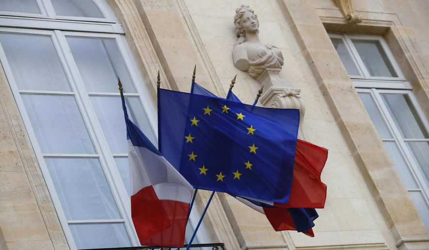 In this Monday, Dec. 10, 2018, file picture European and French flags are flapping at the Elysee Palace in Paris, during a meeting with French President Emmanuel Macron and local, national political leaders, unions, business leaders and others to hear their concerns after four weeks of protests. French Prime Minister Edouard Philippe announced Thursday that the government will start hiring 600 extra government employees including customs agents to handle cross-border trade and security. (AP Photo/Francois Mori, File)