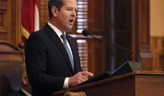 Georgia Gov. Brian Kemp delivered his first State of the State address, Thursday, Jan. 17, 2019, in Atlanta.  (Bob Andres/Atlanta Journal-Constitution via AP)