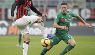 "FILE - In this Saturday, Dec. 22, 2018 filer, AC Milan's Gonzalo Higuain, left, challenges for the ball with Fiorentina's Jordan Veretout during a Serie A soccer match between AC Milan and Fiorentina, at the San Siro stadium in Milan, Italy. Amid reports of an imminent move to Chelsea and a mysterious fever, Gonzalo Higuain again lost his cool against his former club in what could have been his last match for AC Milan. Higuain was on the bench for most of Wednesday's Italian Super Cup against Juventus, officially due to ""fever"", but came on for the final 20 minutes. The Argentina forward had little impact and could not prevent 10-man Milan losing to Juventus but still made the headlines for the wrong reasons. (AP Photo/Luca Bruno, File )"