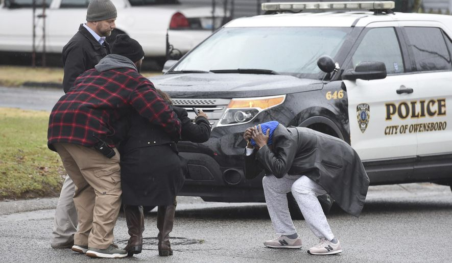 People arriving to the scene of a shooting involving multiple people react outside the home in Owensboro, Ky., Thursday, Jan. 17, 2019. (Alan Warren/The Messenger-Inquirer via AP)