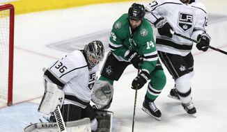 Dallas Stars left wing Jamie Benn (14) tries to score a goal against Los Angeles Kings goaltender Jack Campbell (36) and defenseman Alec Martinez (27) during the third period of an NHL hockey game in Dallas, Thursday, Jan. 17, 2019. The Kings won 2-1 (AP Photo/LM Otero)