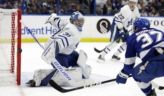 Toronto Maple Leafs goaltender Frederik Andersen (31) makes a save on a shot by Tampa Bay Lightning center Yanni Gourde (37) during the second period of an NHL hockey game, Thursday, Jan. 17, 2019, in Tampa, Fla. (AP Photo/Chris O'Meara)