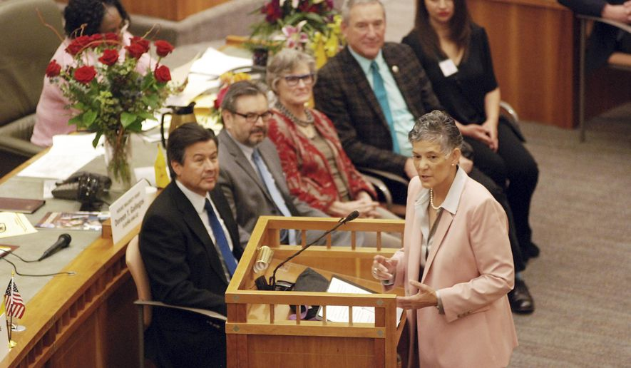 Supreme Court Chief Justice Judith Nakamura, right, delivers the annual State of the Judiciary address to the New Mexico Legislature in Santa Fe, N.M., on Thursday, Jan. 17, 2019. Nakamura is defending state courts against criticisms of pre-trial release programs and is calling on lawmakers to pass bills that could streamline the court system and fund more employee training. (AP Photo/Morgan Lee)