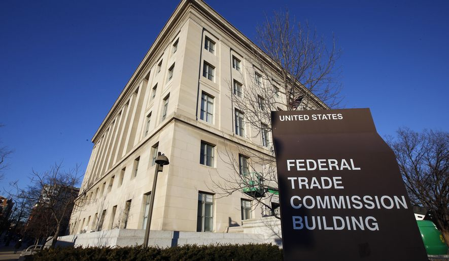 FILE - This Jan. 28, 2015, file photo, shows the Federal Trade Commission building in Washington. Consumer advocates and the data-hungry technology industry are drawing early battle lines in advance of an expected fight over a national privacy law. Privacy organizations on Thursday, Jan. 17, 2019, suggested sidelining the Federal Trade Commission with a new data-protection agency empowered to police U.S. industry.  (AP Photo/Alex Brandon, File) **FILE**