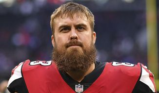 FILE - In this Dec. 2, 2018, file photo, Atlanta Falcons offensive guard Ben Garland walks off the field after an NFL football game against the Baltimore Ravens, in Atlanta. Ben Garland and former Detroit Lions quarterback Eric Hipple are the finalists for the NFL's Salute To Service Award. The recipient of the award, presented by USAA, will be revealed on Feb. 2 during the NFL Honors show when The Associated Press announces its annual league awards, including MVP. (AP Photo/Danny Karnik, File)