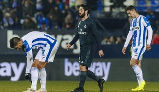 Real Madrid's Isco Alarcon, center, reacts during a Spanish Copa del Rey soccer match between Leganes and Real Madrid at the Butarque stadium in Leganes, Spain, Wednesday, Jan. 16, 2019. (AP Photo/Valentina Angela)