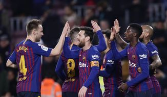 FC Barcelona's Dembele, right, celebrates after scoring with teammates his side's second goal during a Spanish Copa del Rey soccer match between FC Barcelona and Levante at the Camp Nou stadium in Barcelona, Spain, Thursday, Jan. 17, 2019. (AP Photo/Manu Fernandez)