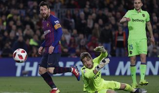 FC Barcelona's Lionel Messi, center, kicks the ball to score his side's third goal during a Spanish Copa del Rey soccer match between FC Barcelona and Levante at the Camp Nou stadium in Barcelona, Spain, Thursday, Jan. 17, 2019. (AP Photo/Manu Fernandez)
