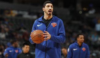 "FILE - In this Jan. 1, 2019, file photo, New York Knicks center Enes Kanter, of Turkey, warms up prior to the team's NBA basketball game against the Denver Nuggets, in Denver. Turkish media reports said Wednesday, Jan. 16, 2019, that Turkish prosecutors are seeking an international arrest warrant and had prepared an extradition request for Kanter, accusing him of membership in a terror organisation. Sabah newspaper said prosecutors were seeking an Interpol ""Red Notice"" citing Kanter's ties to Fethullah Gulen, who Turkey blames for a failed 2016 coup, and accusing him of providing financial support to the group. (AP Photo/David Zalubowski, File)"