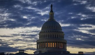 In this Jan. 8, 2019, file photo dawn arrives at the Capitol in Washington. On Thursday, Jan. 17, the Labor Department reports on the number of people who sought unemployment benefits last week, a figure likely to be inflated by applications from federal employees who aren't working because of the partial government shutdown. (AP Photo/J. Scott Applewhite, File)